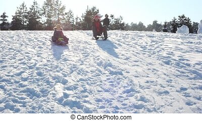 Mother and son ride with mountains on sled