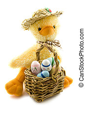 Easter fun - Duck with painted eggs isolated over white