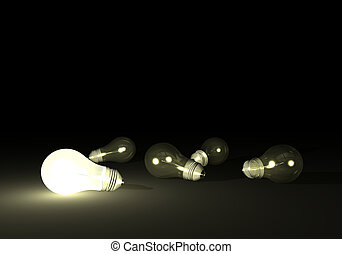 Light Bulbs - Lit bulb next to unlit light bulbs