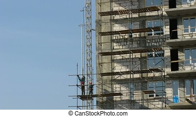 Builders erect scaffolding. Time lapse