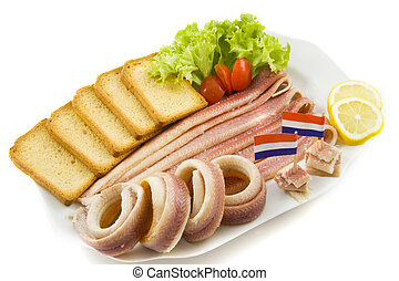 Paling on a plate with flags toast tomato salad and lemon