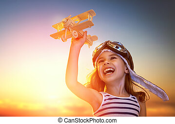 girl playing with toy airplane - dreams of flight! child...