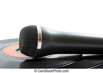 Mic on plastic - Microphone laying on vinyl records isolated...