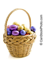 Easter basket - Basket filled with chocolate eggs isolated...