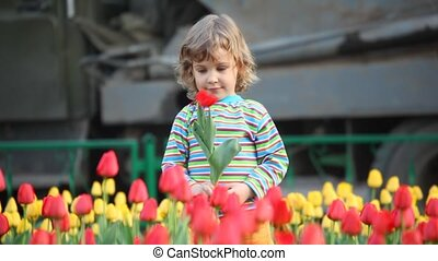 Girl plays with flower