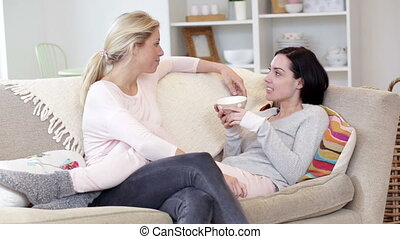 Female couple relaxing at home