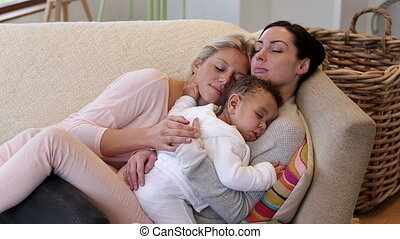 Same sex couple asleep with son - Same sex couple sleeping...