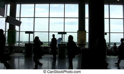 People in a hall of the airport, a shade on a floor