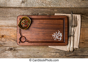 Chopping cutting board, seasonings and meat fork and knife...