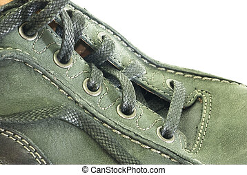 Shoe laces and leather stitches