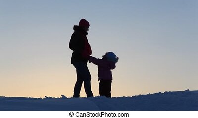 Silhouette mother with child falling