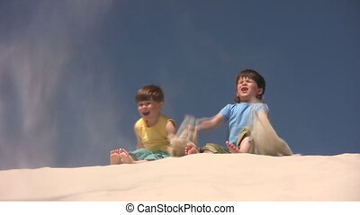 Boys plays with the sand