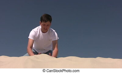 Young man making the sandhill