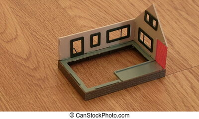 The house model is under construction on a floor. Time lapse.