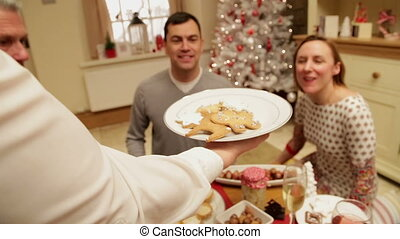Yummy, gingerbread! - Family and friends gathered at...