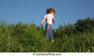 girl exercising on meadow