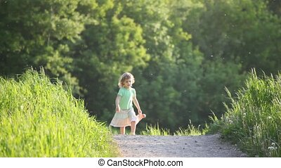 girl walking on road with toy