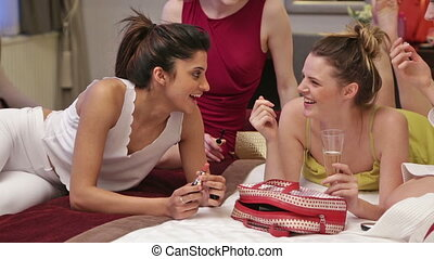 Four women getting ready in hotel - Four women are sharing a...