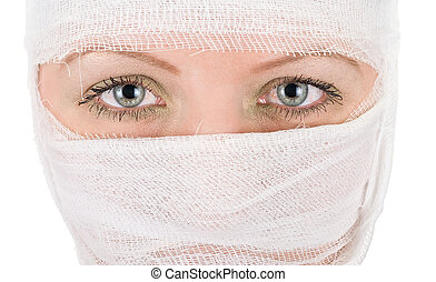 woman with bandages on her face closeup on white
