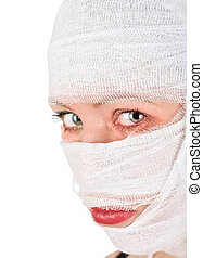 woman with bandages on her face on white