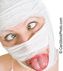 Crazy woman with bandages on her face on white