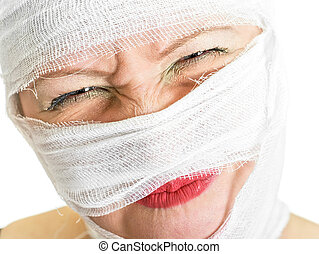 pain - woman with bandages on her face on white