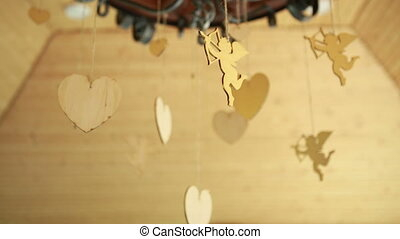 wedding decoration in the form of wooden hearts and Cupid...