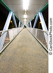 It is a modern flyover at night.