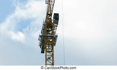 Ascent of the booth of the crane. Time lapse