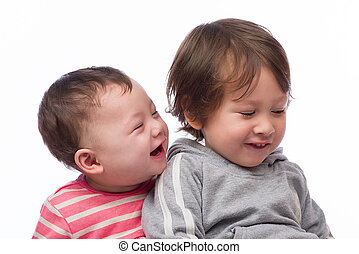 Brother and Sister Portrait - A portrait of a cute and...