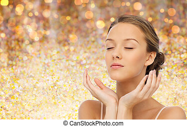 young woman face and hands - beauty, people, skincare and...