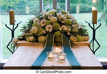 Coffin in crematory - A coffin in a crematory with a flower...