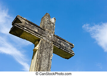 Cross of stone - An old cross made of stone in the ancient...