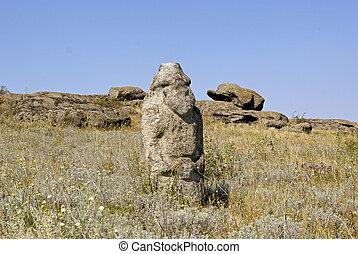 Stone idol in the steppe National Park Stone Tombs Donetsk...