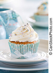 Cupcake for a baby shower - Blue and white cupcake decorated...