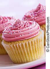 Pink cupcakes - Cupcakes decorated with pink frosting and...
