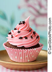 Cupcake - Pink cupcake decorated with chocolate stars