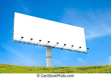 blank billboard with blue sky and green grass