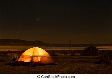 Camping at night - Camp site with illuminated tent in the...