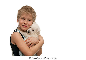 Portrait of a boy with a white puppy - A boy is holding a...