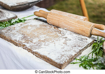 wooden board and rolling-pin - working surface for dough...