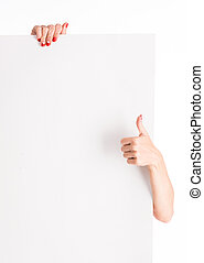 hands holding big blank paper with thumb up - woman hands...