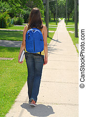Going To School - Young girl with backpack and book is going...