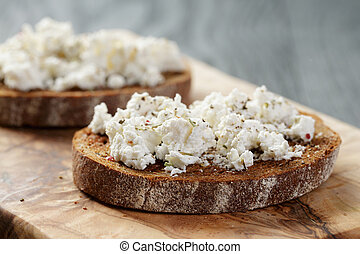 rye bread grated with garlic and ricotta cheese
