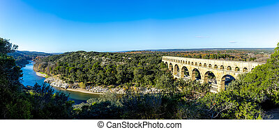 Pont du Gard is an old Roman aqueduct near Nimes in Southern...
