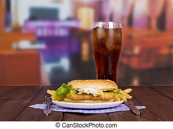 Burger with cold glass of soda
