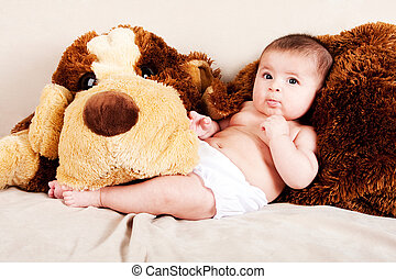 Baby with dog - Cute Caucasian Hispanic unisex baby in arms...