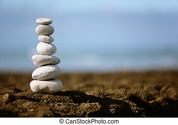 Stacked rocks - A pile of seven stacked rocks on the beach