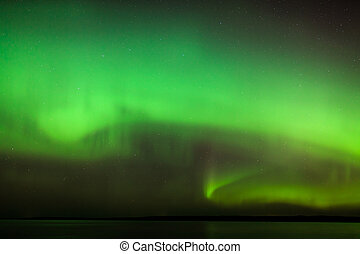 Northern lights over lake in finland - Beautiful northern...
