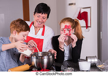 happy family in the kitchen preparing christmas bakery